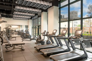 Fitness Center with high ceilings, machines and free weights